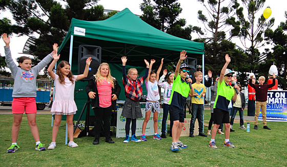 The Solar Buskers and the school's choir performing at a climate festival in town